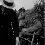 Marietta Pallis, standing, beside F.E. Clements, sitting. Boating in the Norfolk Broads. Photographer Elizabeth Cowles.