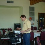Geoff Cunfer setting up the projector for Theodore Binnema's keynote presentation.