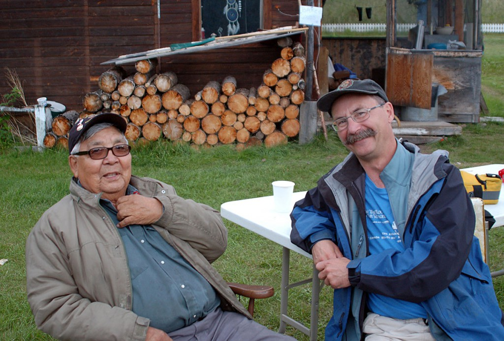Moosehide Percy Henry speaking with David Neufeld. Photo Courtesy of D. Neufeld.