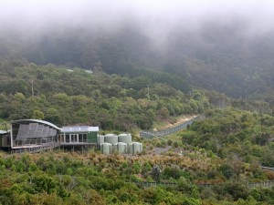 The Orokonui visitor centre with the pest proof fence, foreground. Photo: D Neufeld