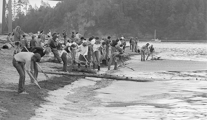 Oil spill cleanup in West Vancouver at Ambleside, 1973. Source: John Denniston