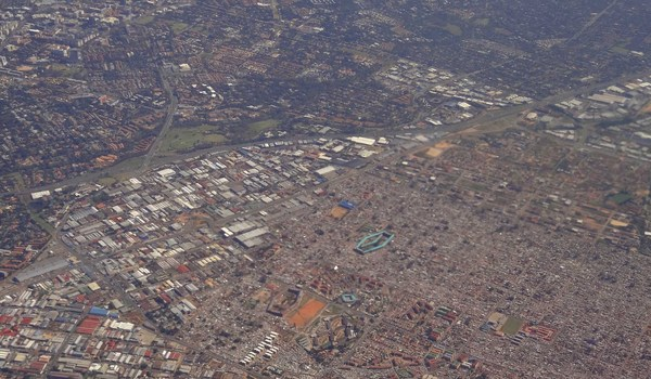 Aerial View of Johannesburg Illustrates Divide Between Wealthy Neighborhoods with Trees and Barren Poorer Neighborhoods. Source: Flickr/ Michis