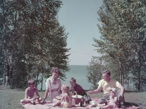 """A family of six picnic at Waskesiu, Prince Albert National Park, Saskatchewan, 1950."" Source: Library and Archives Canada"