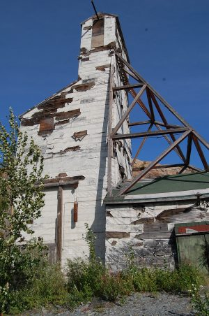 Abandoned headframe at Giant Mine, Yellowknife, NWT. Photo by Arn Keeling.