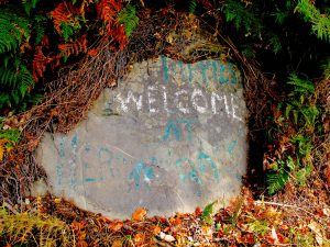 """Hippies Welcome at Heron Rocks."" There is debate locally whether this was meant ironically."