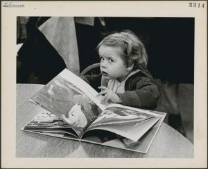 Three-year-old Jennifer Adair with a book, Montreal (1930-1960) Library & Archives Canada